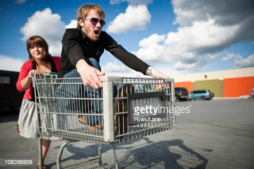 Young Couple in Shopping Cart Race