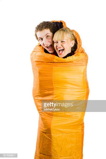 Young couple in sleeping bag
