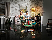 young couple in sofa in a flooded room