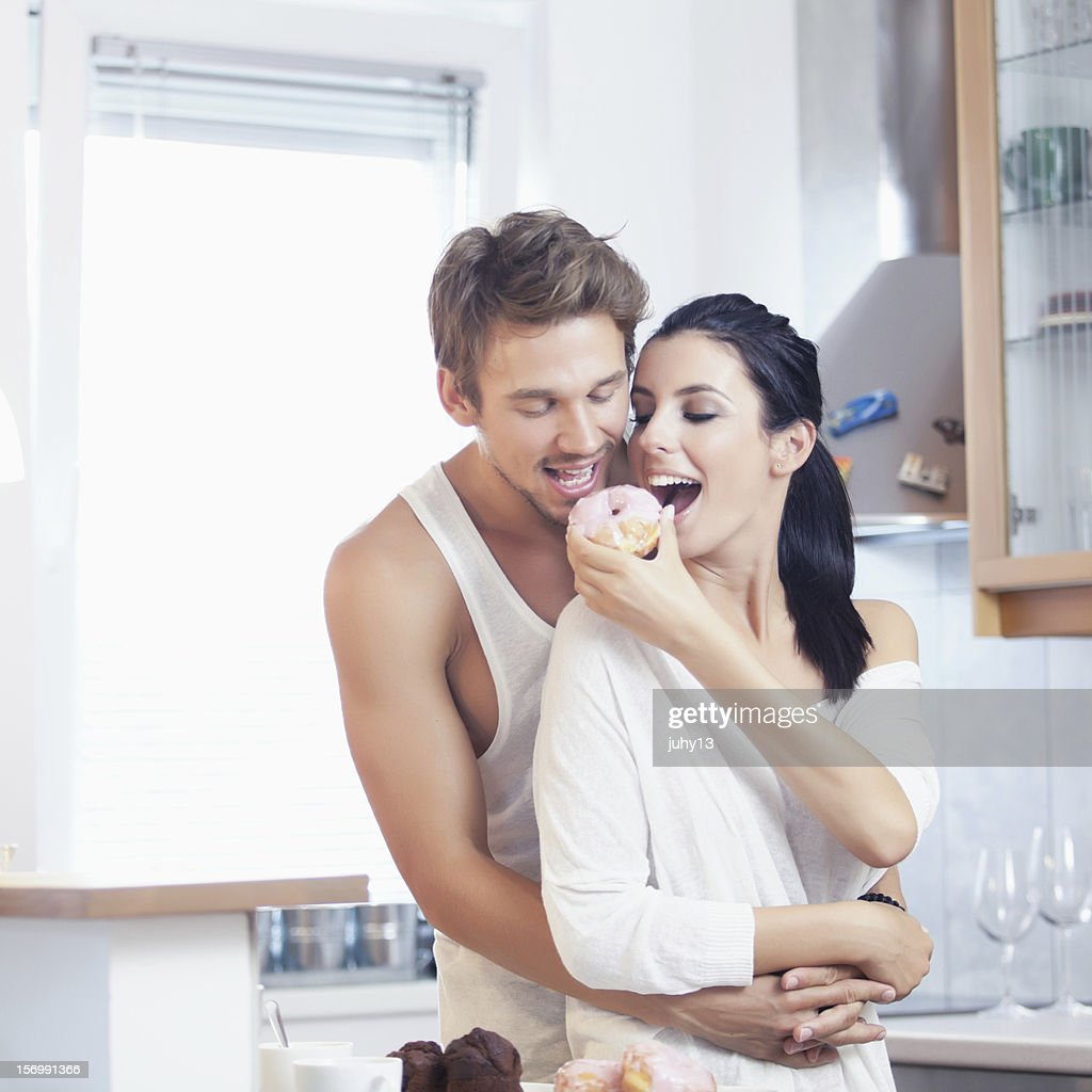 Young couple in the kitchen : Stock Photo
