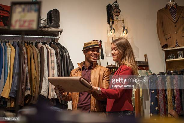 Young couple in vintage clothes shop
