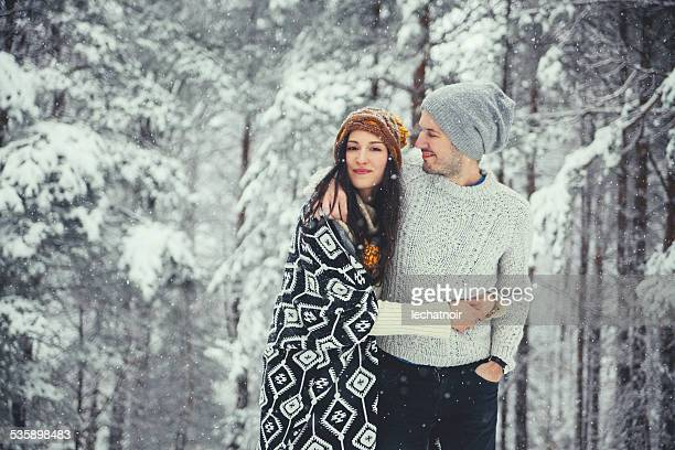 young couple in winter clothing
