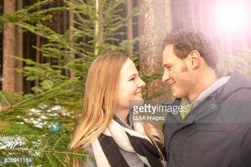 Young couple in winter forest, Bavaria, Germany : Stock Photo