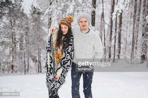 Young couple in winter nature : Stock Photo