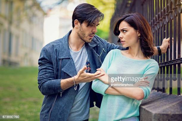 Young couple is arguing on the street
