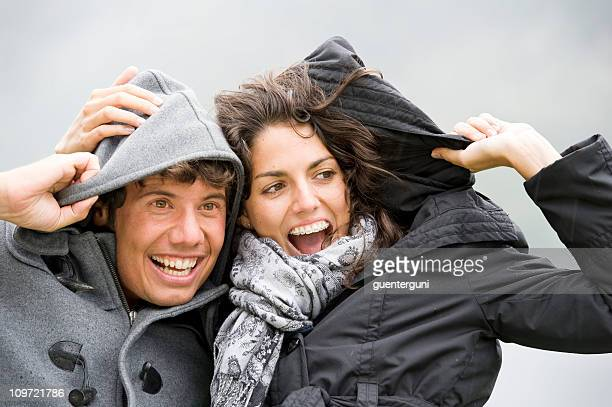 young couple is having fun on a rainy day