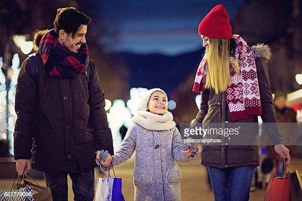 Young couple is walking on the street at Xmas