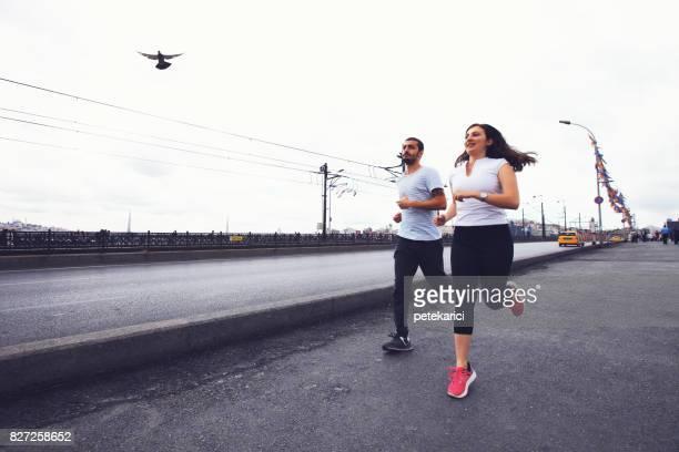 Young couple jogging in Istanbul, Galata Bridge