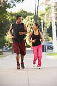 Young Couple Jogging On Street