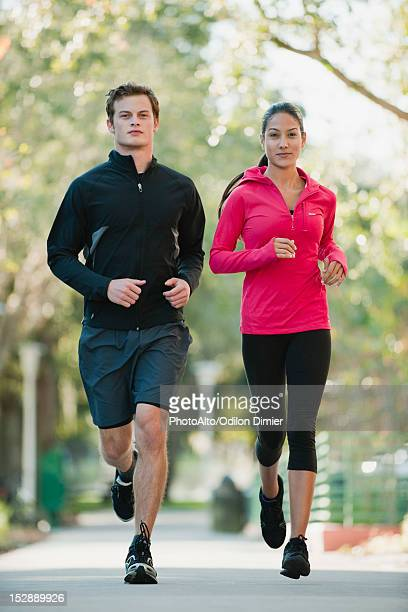 Young couple jogging side by side