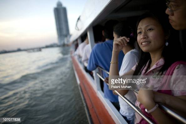 A young couple journey down the Chao Phraya river on a passenger ferry on January 3 2007 in Bangkok Thailand The Chao Phraya is Bangkok's main...