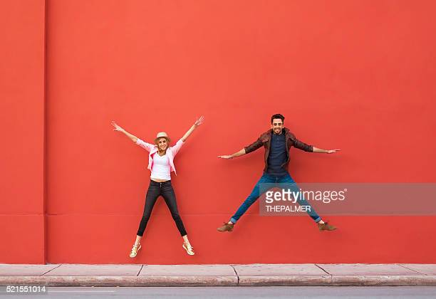 Young couple jumping for fun