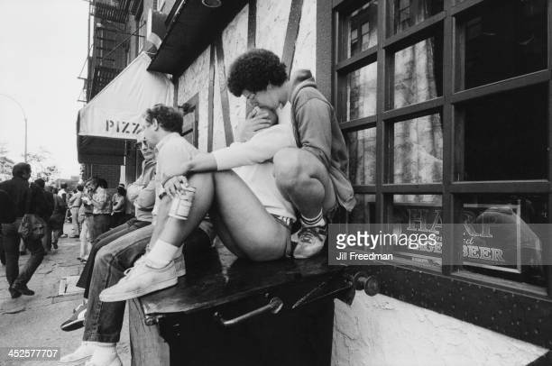 A young couple kiss on the street in Greenwich Village New York City 1979