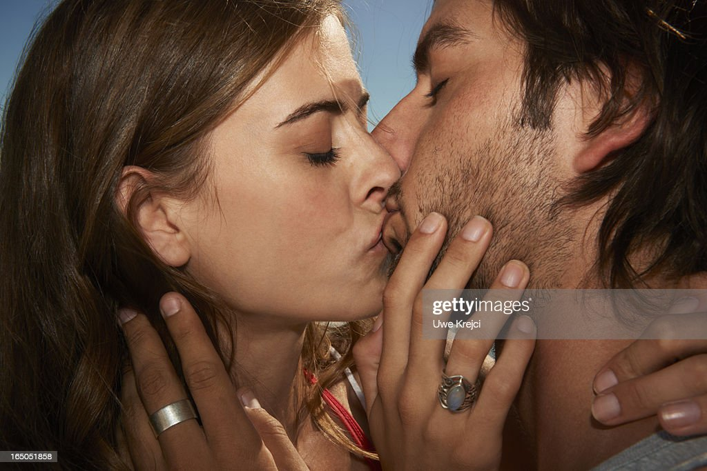 Young couple kissing, close up : Stock Photo