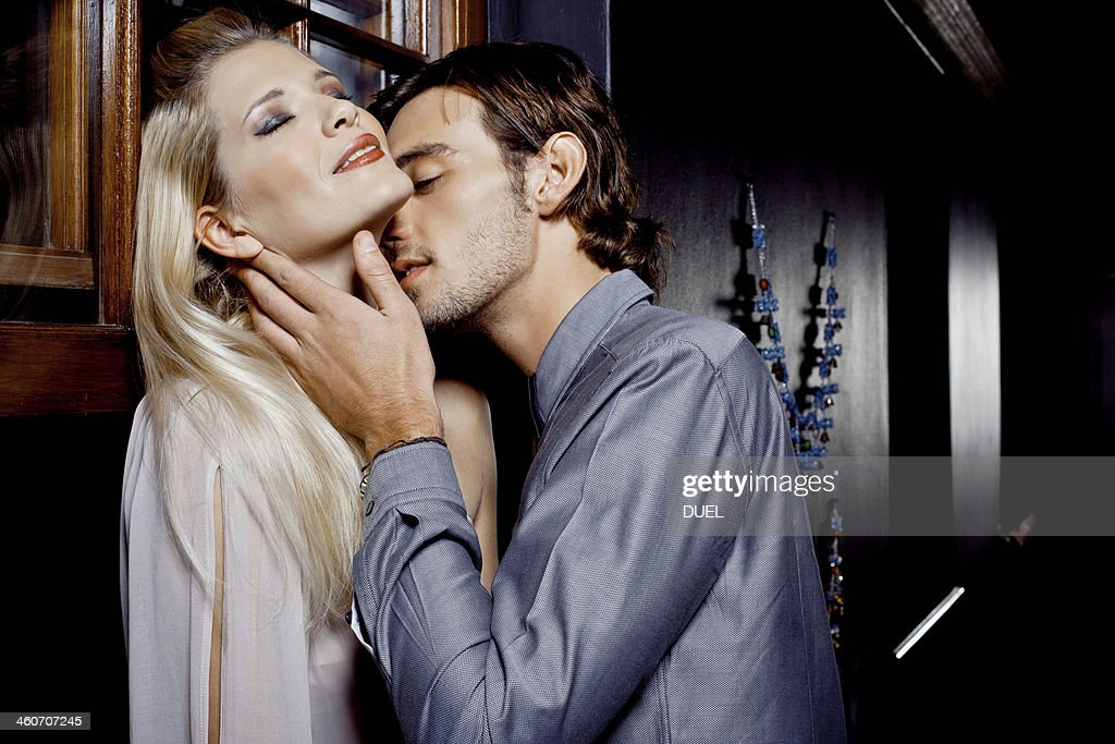 Young couple kissing in nightclub : Stock Photo