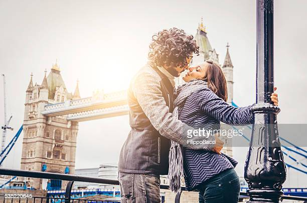 Young Couple Kissing Near Tower Bridge In London