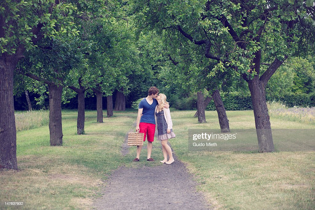 Young couple kissing on alley. : Stock Photo