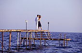 Young couple kissing on jetty