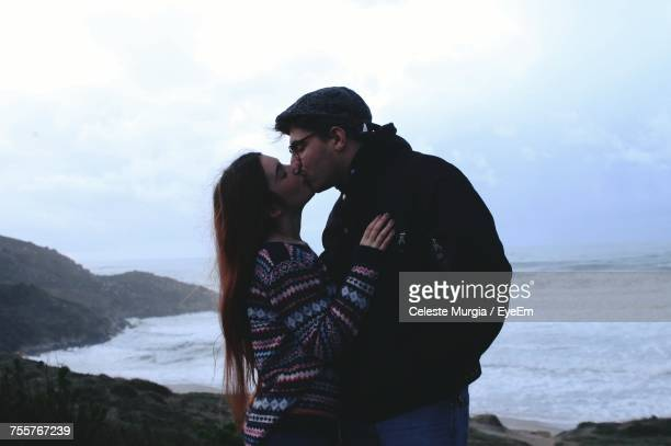 Young Couple Kissing On Shore