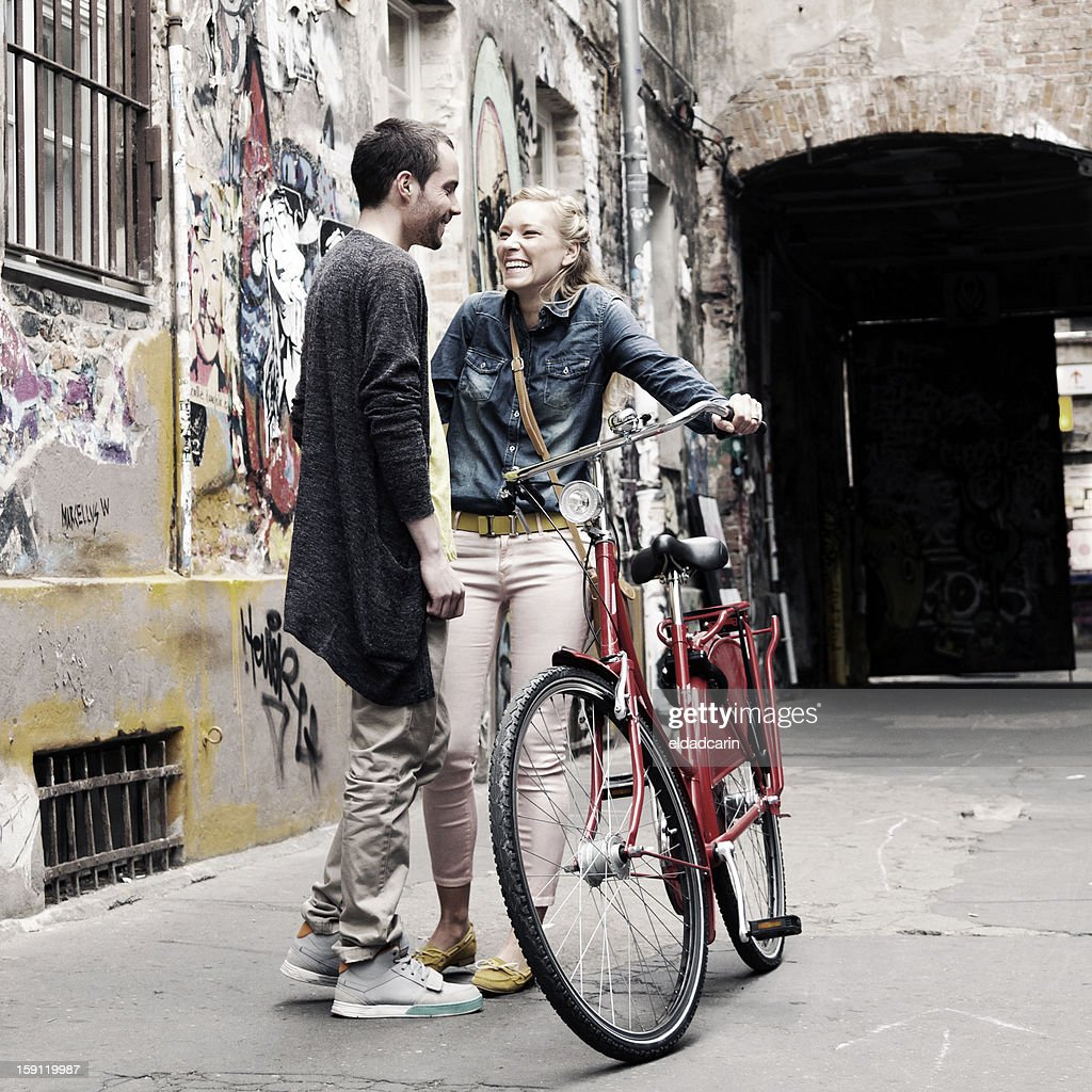 Young Couple Laughing in Alley Bleached : Stock Photo