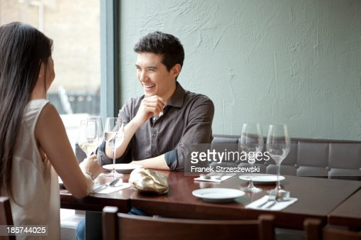 Young couple laughing in restaurant