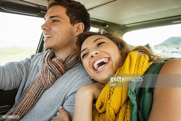 Young couple laughing whilst driving, Cape Town, Western Cape, South Africa