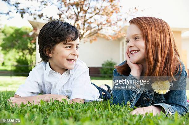Young couple laying in grass