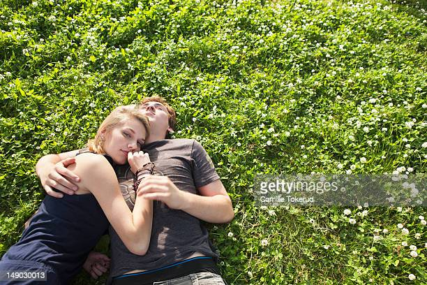Young couple laying on the grass