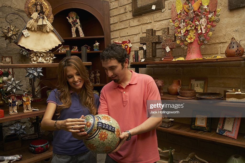 Young couple looking at an antique urn