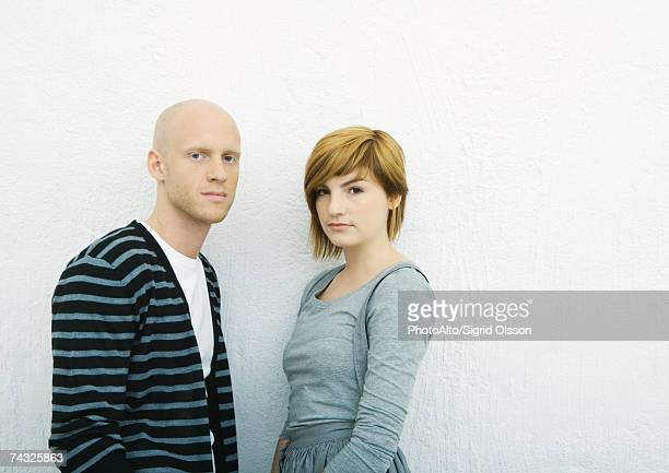 Young couple, looking at camera, portrait, white background