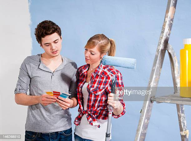 Young couple looking at different wall colors