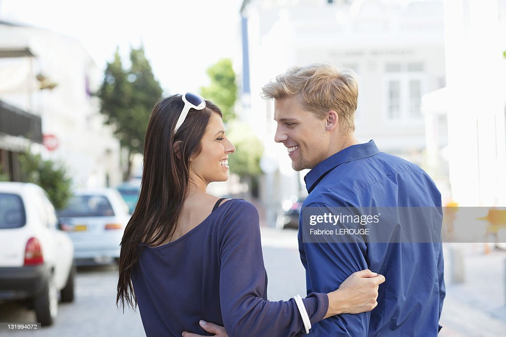 Young couple looking at each other and smiling : Stock Photo