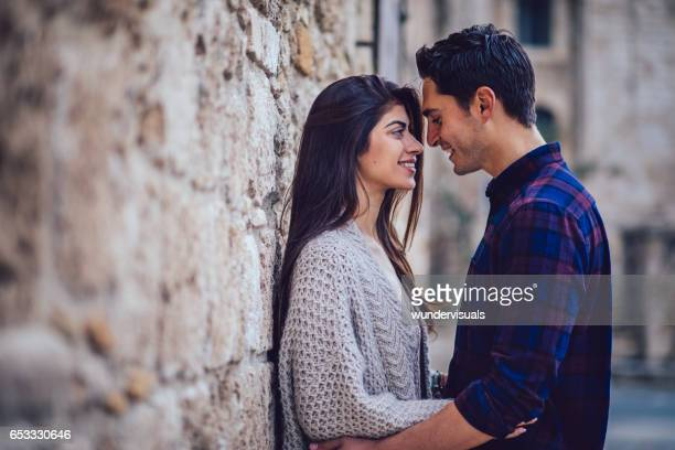 Young couple looking at each other in mediterranean background