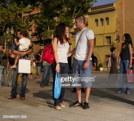Young couple looking at each other outdoors : Stock Photo