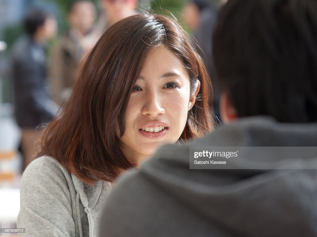Young couple looking at each other : Stock Photo