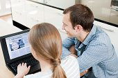 Young couple looking at insurance on laptop