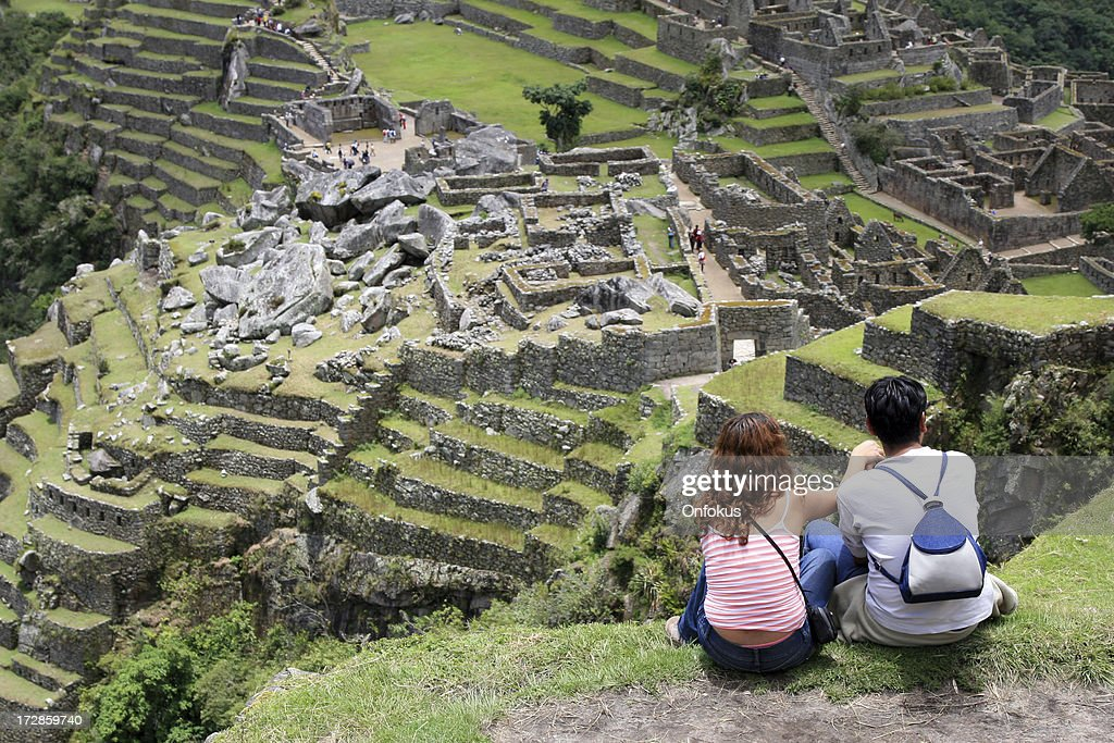 Young couple looking the famous Machu Picchu