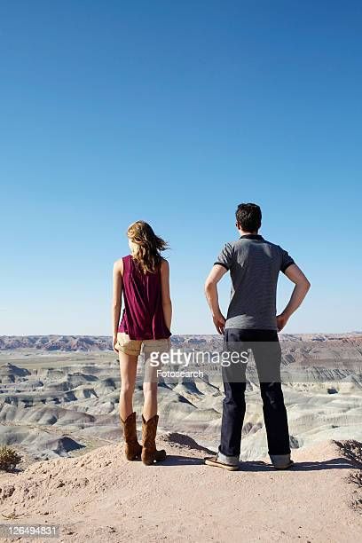 Young couple looking at rocky landscape, Arizona, USA