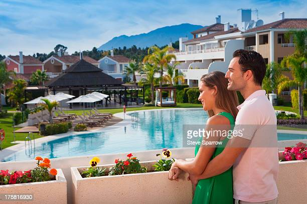 Young couple looking at view at holiday resort