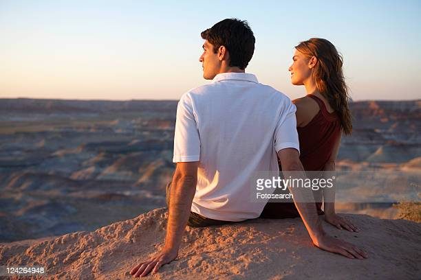 Young couple looking at view on cliff, Arizona, USA