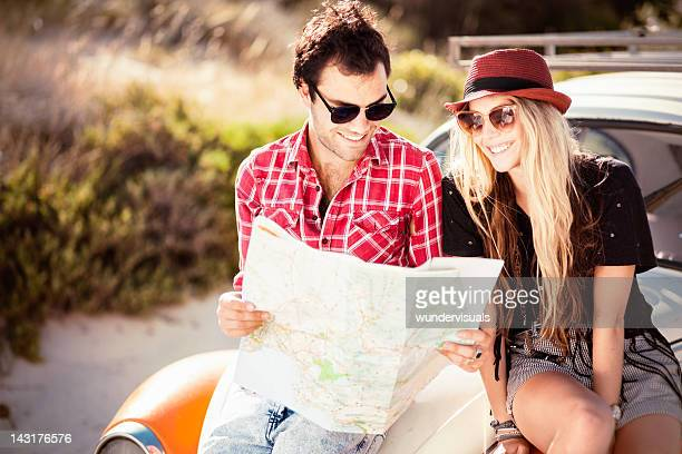 Young Couple Looking For Directions On the Map