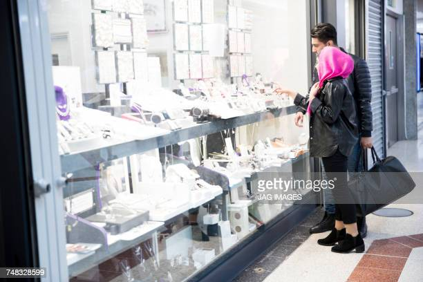 Young couple, looking in jewellers shop window