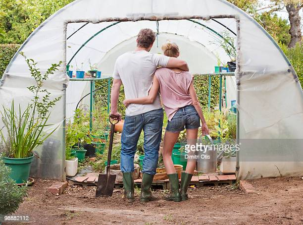 Young couple looking into nursery