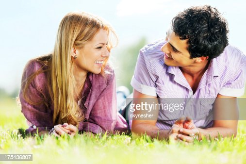 Young couple lying in park