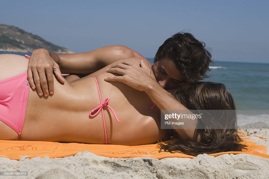 young naked couple at beach