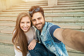 Young couple makes his selfie.