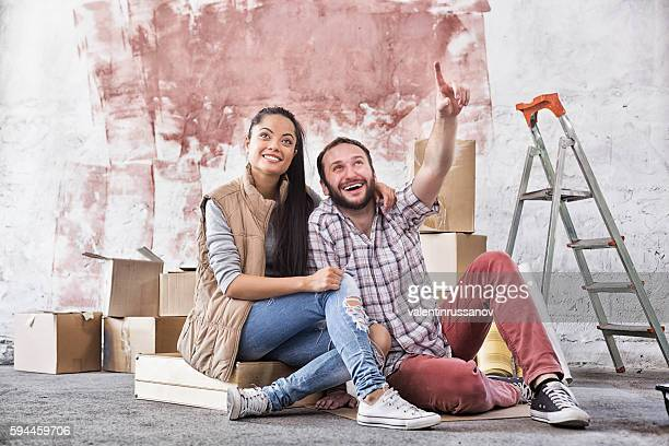 Young couple making home improvement