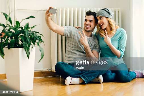 Young Couple Making Selfies At Home.
