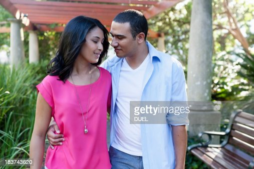Young couple, man with arm around woman : Stock Photo