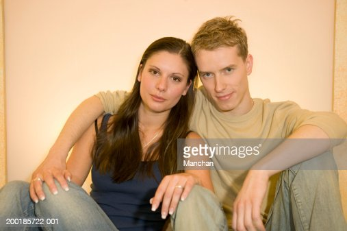 Young Couple Mans Arm Around Womans Shoulder Portrait ...